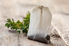 Tea bag and fresh thyme Kuvituskuvat
