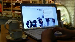 Apple store USA on tablet computer screen with modern Iwatch 2 on it Stock Footage