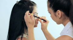 Make-up artist applying makeup Stock Footage