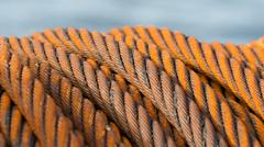 Abandoned rusty steel cable - Selective focus Stock Photos