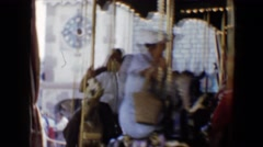 1959: various people riding on a traditional amusement park merry-go-round Stock Footage