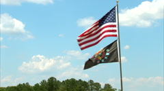 U.S. Flag and Vietnam Insignia Flag Waves in Wind Stock Footage