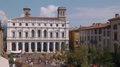 Bergamo, Palazzo Nuovo palace in old square Stock Footage