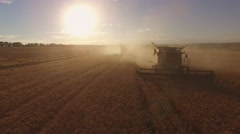 Harvester in cloud of dust. Stock Footage