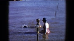 1959: swimming with the family members and pet is full of fun and happiness Stock Footage