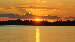 Colour Sunset Over The River With Sun And Orange Clouds Stock Footage