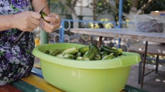 Hands of woman washing cucumbers in the yard. Home canning. Stock Footage