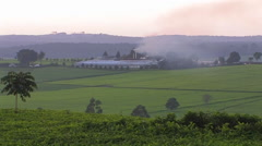 Smoke billows from a building on a farm. Stock Footage