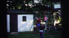 1972: boy jumps from swing and lands on the ground LYNBROOK, NEW YORK Stock Footage