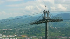Funicular cable car in the summer in the mountains. Cabs passes a beautiful Stock Footage