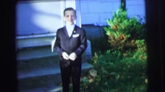 1972: young boy in his fancy tuxedo makes funny face outside home LYNBROOK Stock Footage