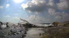 A strong wave splash over the wavebreaker, slow motion Stock Footage