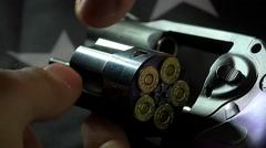 Slow Motion Loading 357 Magnum Ammo Into A Revolver Stock Footage