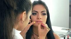 Lip makeup. makeup artist Stock Footage