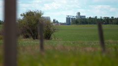 Agricultural storage facility with field in the foreground. Stock Footage