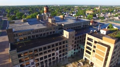 Flying over abandoned industrial factory in very dilapidated condition Stock Footage