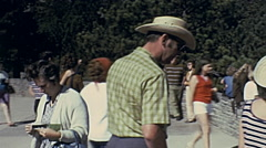 Mount Rushmore 1975: people watching the Presidents sculptures Stock Footage