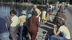 Yellowstone National Park 1975: people fishing over a bridge Stock Footage