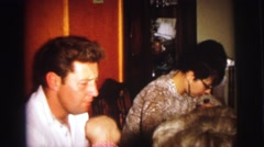 1972: a family gathered around a dining room table enjoying dinner together Stock Footage