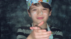 4k Colourful Shot of a Cook Child Clapping His Hands with Flour  Stock Footage