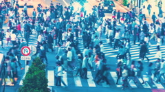 Time-lapse of people and traffic crossing a famous Japanese intersection Stock Footage