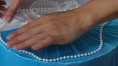 Female hands stick beads on a box of glue gun. Production of gift wrapping Stock Footage