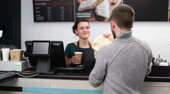 Man taking the package and cup of coffee at the fast food restaurant Stock Footage