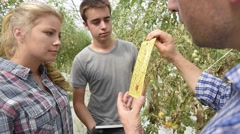 Students in training course in organic greenhouse Stock Footage