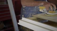 Closeup of carpenter using sander Stock Footage