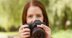 4k, young photographer takes a photo with her digital camera. Slow motion. Stock Footage