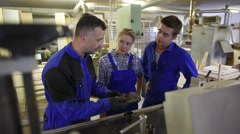 Professional teacher showing carpentry machinery to students Stock Footage