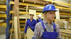 Students in carpentry apprenticeship carrying wood Stock Footage
