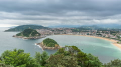 High angle view of San Sebastian Concha Bay and dynamic clouds Stock Footage