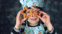 4k Colourful Shot of a Cook Child Holding Start Biscuit Shapes Stock Footage