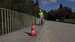 Road construction worker collect road signs Stock Footage