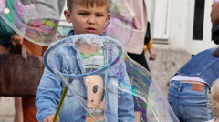 Playful little boy huge soap bubble Stock Footage
