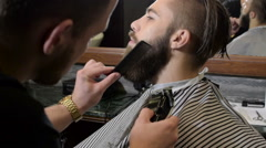 Beard trimming process from professional hairdresser in barbershop Stock Footage