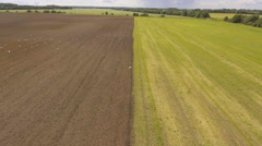 Tractor plowing a field.Aerial video Stock Footage