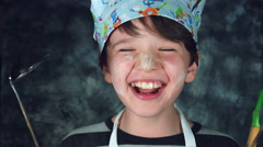 4k Colourful Shot of a Cook Child Holding Tools and Laughing out Loud Stock Footage