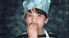 "4k Colourful Shot of a Cook Child Showing Tasty or ""Bellissimo"" Stock Footage"