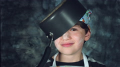 4k Colourful Shot of a Cook Child Putting a Pan on his Head Stock Footage