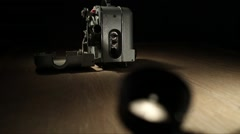 Vintage 8mm camera and projector Stock Footage