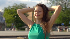 Happy girl resting in the city and enjoying sun, steadycam shot, slow motion sho Stock Footage