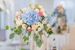 Fresh floral composition on the holiday table. Beautifully organized event - Stock Photos