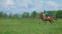 Beautiful girl riding a horse in countryside. Gallop Stock Footage