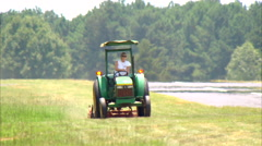 Young Woman MCU Mowing Grass Runway Stock Footage