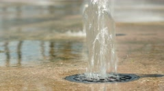Water pouring out of the ground. Man's foot plays with water. The flow of water Stock Footage