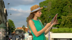 Absorbed girl standing in the city and reading map Stock Footage