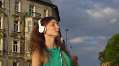 Happy girl going round while listening music, steadycam shot, slow motion shot Stock Footage