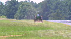 Young Woman WS Mowing Grass Runway Stock Footage